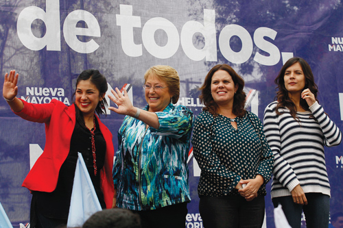 Chile's president Michelle Bachelet, second left, is pictured during a campaign rally in 2013 with newly elected members of Congress Karol Cariola, left, granddaughter of former president Salvador Allende; Maya Fernandez, second right; and former student leader Camila Vallejo, right.